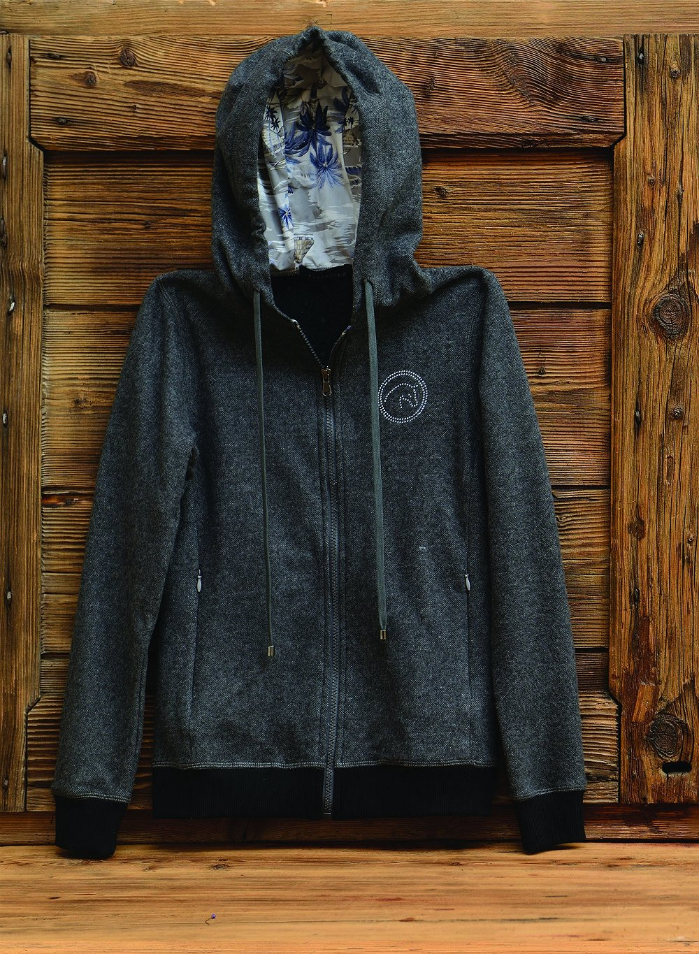 Charcoal grey sweatshirt with zip and hood, blue and grey palm patterned internal details.